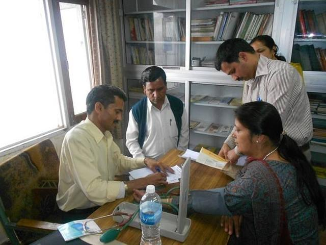 Doctor treating the patients in the Free Ayurvedic Medical Camp at VK Shimla