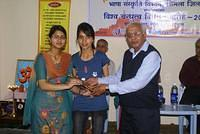 Winners of Utho! Jaago! Bhashan Pratiyogita receiving trophy during the Viswa Bandhutva Diwas celebration at VK Shimla